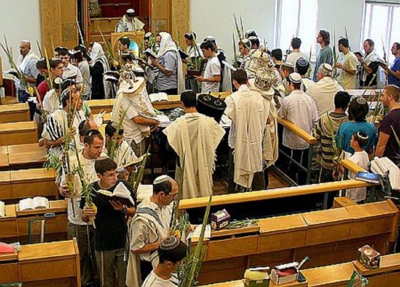 The Torah scrolls are brought to the bema (platform) on Hoshana Rabbah